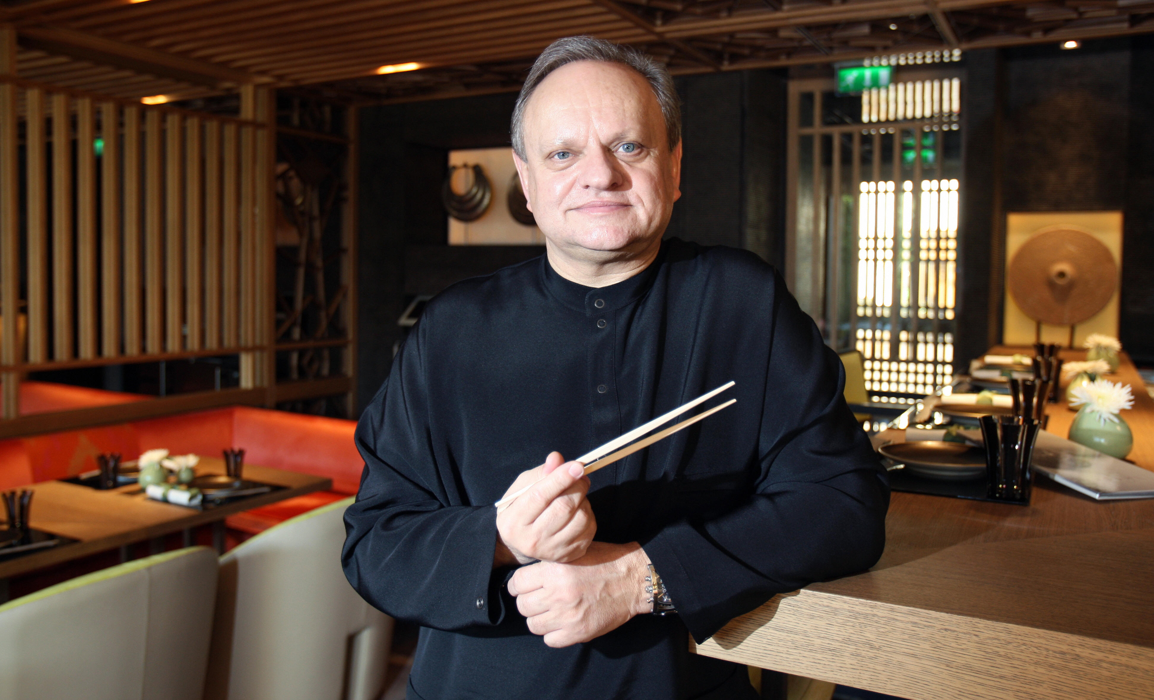 "French chef Joel Robuchon, the world's most starred Chef with a total of 24 stars in the French Michelin 2008 Guide (culinary bible) poses on December 29, 2008 in Monaco where he launched this month his first ever Japanese restaurant ""Yoshi"", at ""Hotel Metropole Monte-Carlo"". At the head of 16 restaurants worldwide, Robuchon, 63, initially learned to cook with nuns. With 24 Michelin stars, the chef is well ahead of his nearest competitor and rival compatriot Alain Ducasse, who has 16, or Britain's Gordon Ramsay, with 12. US chef Thomas Keller is next with seven. AFP PHOTO VALERY HACHE (Photo credit should read VALERY HACHE/AFP/Getty Images)"